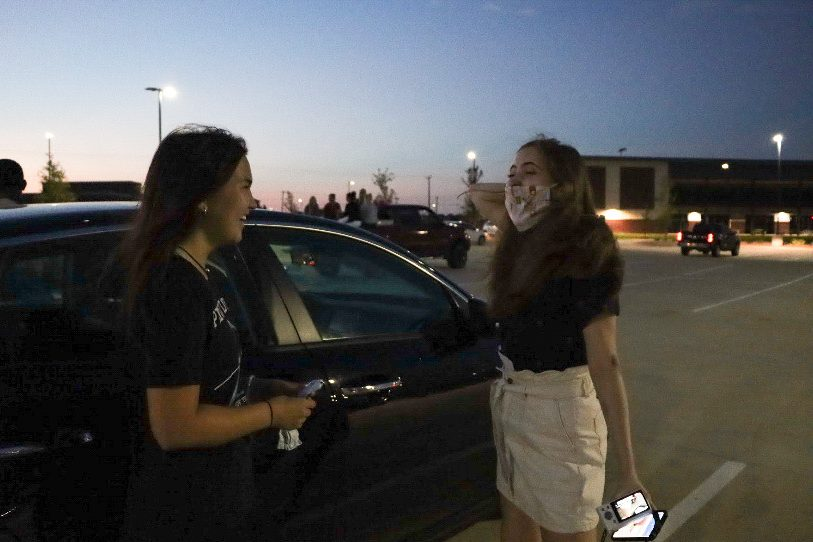 PHS senior Kayli Cook and RHHS senior Nikki Hansen catch up during the Senior Sunrise. The event started at 6:30 a.m. Tuesday morning. Students parked at Childrens Health Stadium to watch the sunrise while Student Council offered donuts and refreshments.