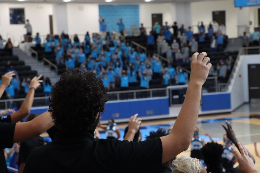 Students put their claws in the air while the band plays the school song. Due to confirmed COVID cases, only athletics and student performers could attend the first pep rally. In addition to the game, the Oct. 2 pep rally has been canceled for safety concerns.