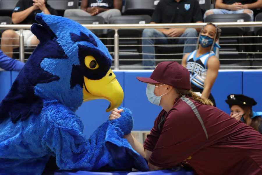 Mascot Rocky arm wrestles a student dressed as a Frisco Heritage fan. Cheer performed a brand new routine at the