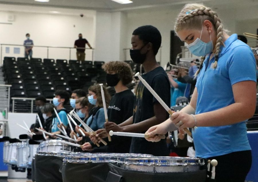 The drum line plays the school song towards the end of the Sept. 24th pep rally. Although the arena seats were mostly empty, band, cheer and drill team performed for fall athletics. Students just being here is support, football coach and athletic coordinator Mark Humble said. You look around already, and our kids are doing an amazing job. Wearing your Blue Hawks shirts are always good to see.