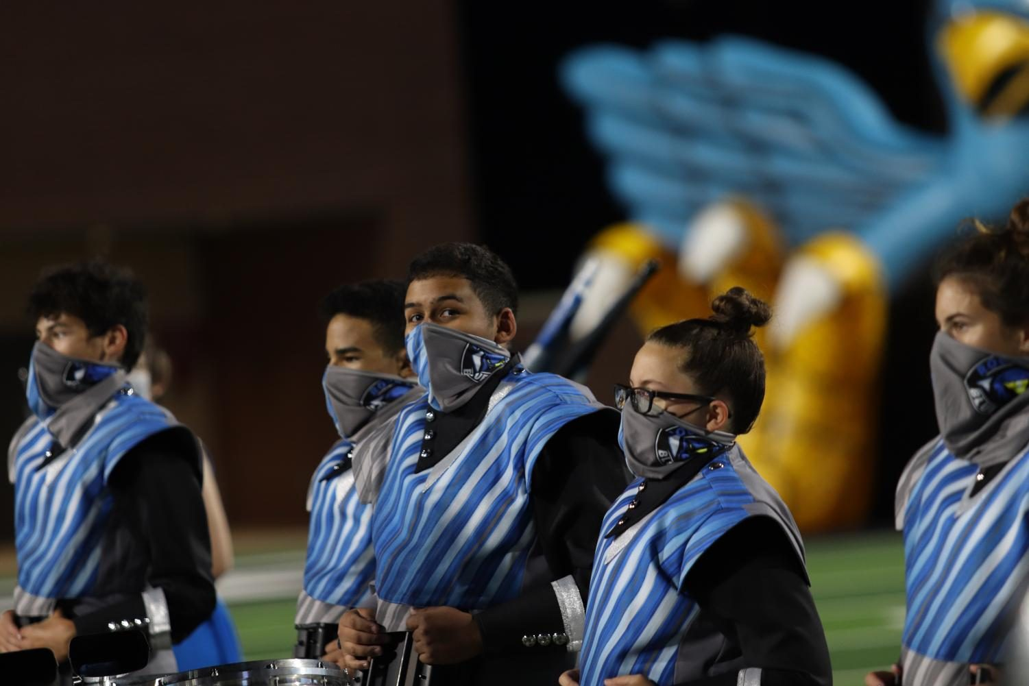 Juan Vera-Gonzalez waits to perform with the rest of the drum line Friday, Oct. 3. Even though the football game was canceled, band, color guard and the Rockettes still performed their half-time performance at Children