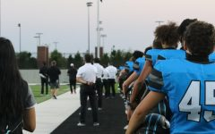 Football players listen to the national anthem at the first home game of the season. Football had to cancel a couple games for COVID-19 concerns. The Forthcoming football game will be played at Children's Health Stadium this Friday, Oct. 23.