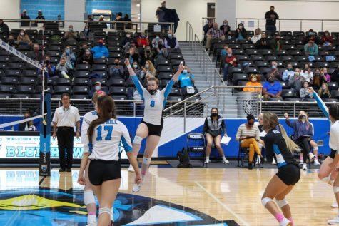 Senior Jenna Curran celebrates a score at volleyball