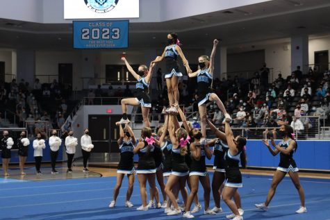 Cheer performs a routine at the Black Out pep-rally. Only seniors and freshmen attended the rally in-person due to coronavirus concerns. Students and staff celebrated for varsity football