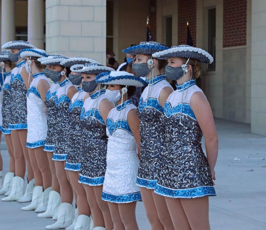 The Rockettes stand in line before performing for the community. Other student performers such as band and color guard were also showcased at the event. The school had originally scheduled the event before the first day of school, but due to coronavirus concerns, the district rescheduled.