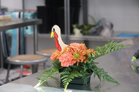 A Thanksgiving-themed floral arrangement sits in the floral classroom before the break. Floral students designed and constructed these arrangements for the Thanksgiving holiday. Students have a few more weeks of classes before the Christmas break.