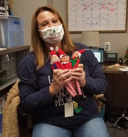 "Student council advisor Shallon Slade holds toy elfs Maximus, Merrick, and Molly. Student council will be hiding them throughout the school. ""It was actually an idea from our student leadership team,""  Teacher Shannon Slade said,"" like a hide and seek, they"