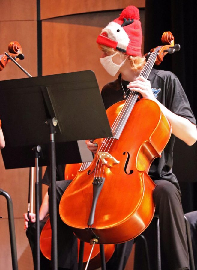 Orchestra student Connor Brooks plays his cello for parents and students at the Christmas Concert. Members wore holiday hats and accessories throughout the Thursday-night show. The event took place in the brand-new auditorium.