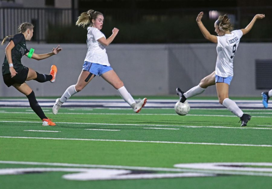 Sophomore and defender Avery Wheeler jumps with teammate to block the ball from Prosper player. This was the district's first time having Prosper and Rock Hill teams compete against one another. The team lost 0-2.