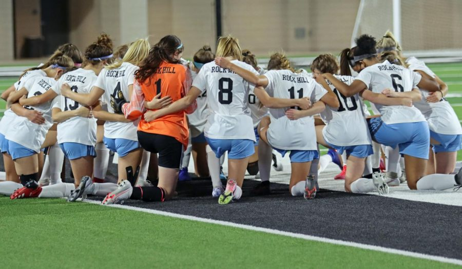 The team huddles up before the start of the game. The girls played against PISD school, Prosper. The game took place at Children's Health Stadium at 7 p.m.