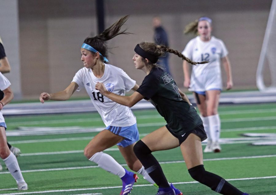 Sophomore forward Noemi Mistretta runs for the ball while Prosper player trails closely. The team lost against their PISD counterpart, but will play against Belton High School next week. The game will be at the PISD stadium.