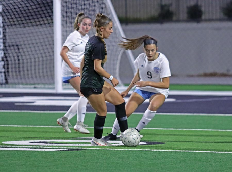 Sophomore Avery Wheeler defends against Prosper player. The team will play again at Childrens Health Stadium against Belton High School Dec. 19. The game will be at 12:30 p.m.
