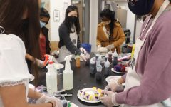 National Art Honor Society tie dyes t-shirts at their Halloween social in October. The society will host their induction ceremony Jan. 14.