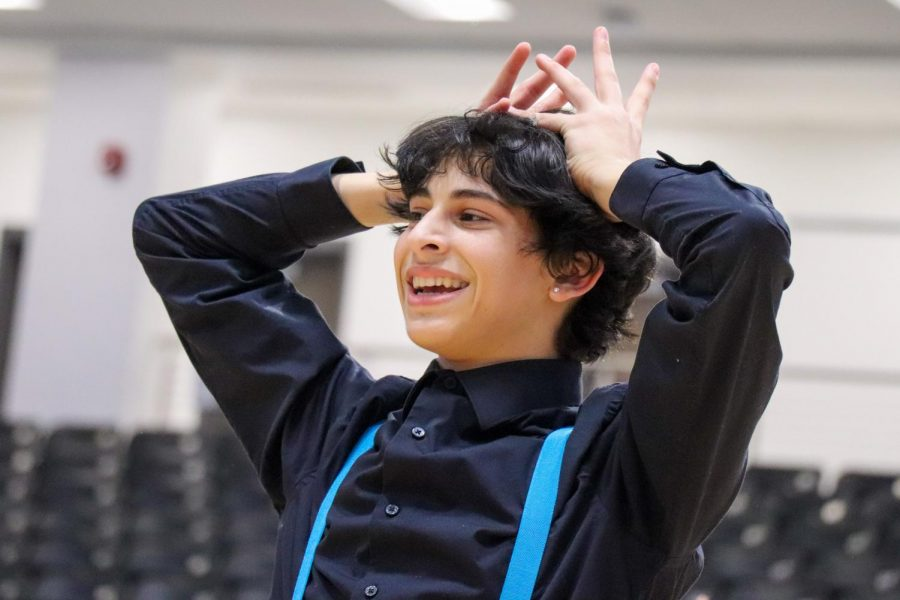 "Sophomore Rami Shihabi dances at a pep rally as the only male on the Rockette drill team. He is the first boy to perform with the Rockettes. ""The first time I saw Rami dance I was astounded at his ability to pick up movement,"" junior Gracie Fisher said. ""If the teacher told him to do something he would just go for it and nail it the first try. He is never afraid of a challenge."""