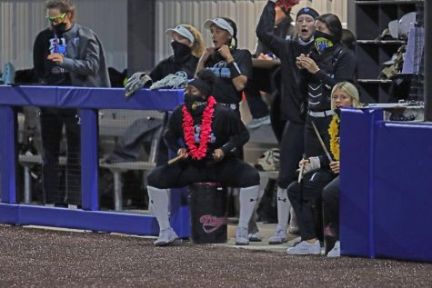 "The softball team rallies together during a game. The team supports each other throughout the game. ""We do a lot of celebrating. We celebrate all the little things because this game is a game of mistakes,"" junior Katerina Luna said. ""Everything that we do correct, we always just try to celebrate just to stay hyped through the game."""