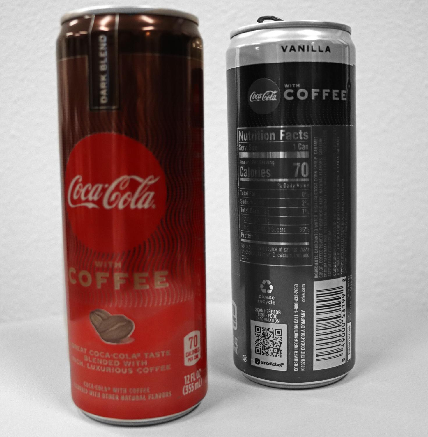 A stylized photo features  two cans of Coca-Colas
