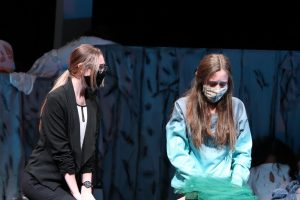 Senior Hayden Miller (Dr. Todd) comforts freshman Sasha Sims (Mary Blanton) in a scene of