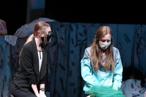 "Senior Hayden Miller (Dr. Todd) comforts freshman Sasha Sims (Mary Blanton) in a scene of ""Cry of the Peacock."" The UIL One Act Play Company advanced through Zone and placed as an ""Alternate School"" at district. The team also took home several individual awards, including Best Technician, All Star Cast and Best Tech Crew."