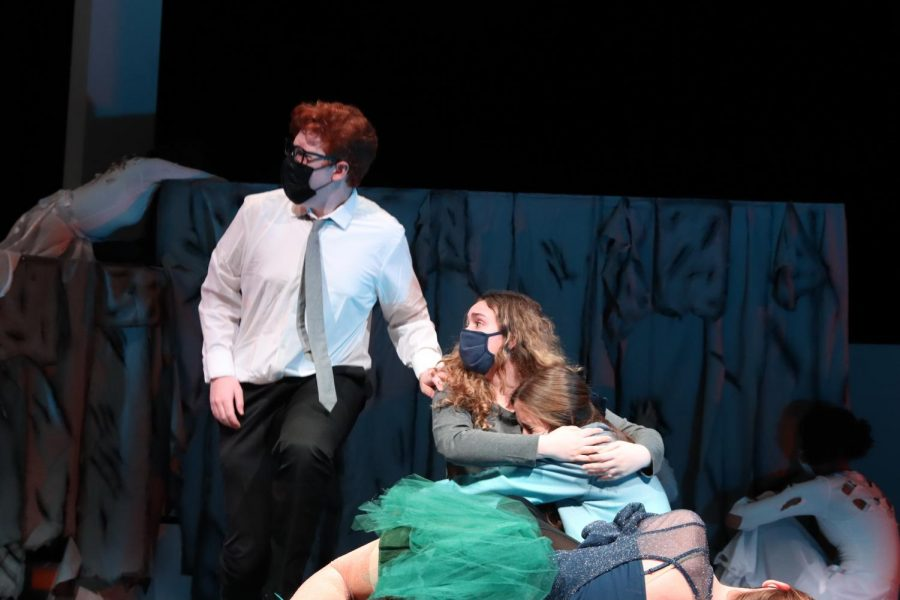 """Freshman Rees Kline (Chase) and senior Haley Medeiros (Beth) comfort freshman Sasha Sims (Mary) while she looks on at her imaginary friend Charlie played by freshman Taylor Bedford. """"I think my favorite part about being in UIL was how we were able to use our creativity and ideas to create the best show possible,"""" Kline said. """"The competition side of theater gave us something more to work towards besides just a public performance, and helped us develop a passion for theater."""""""