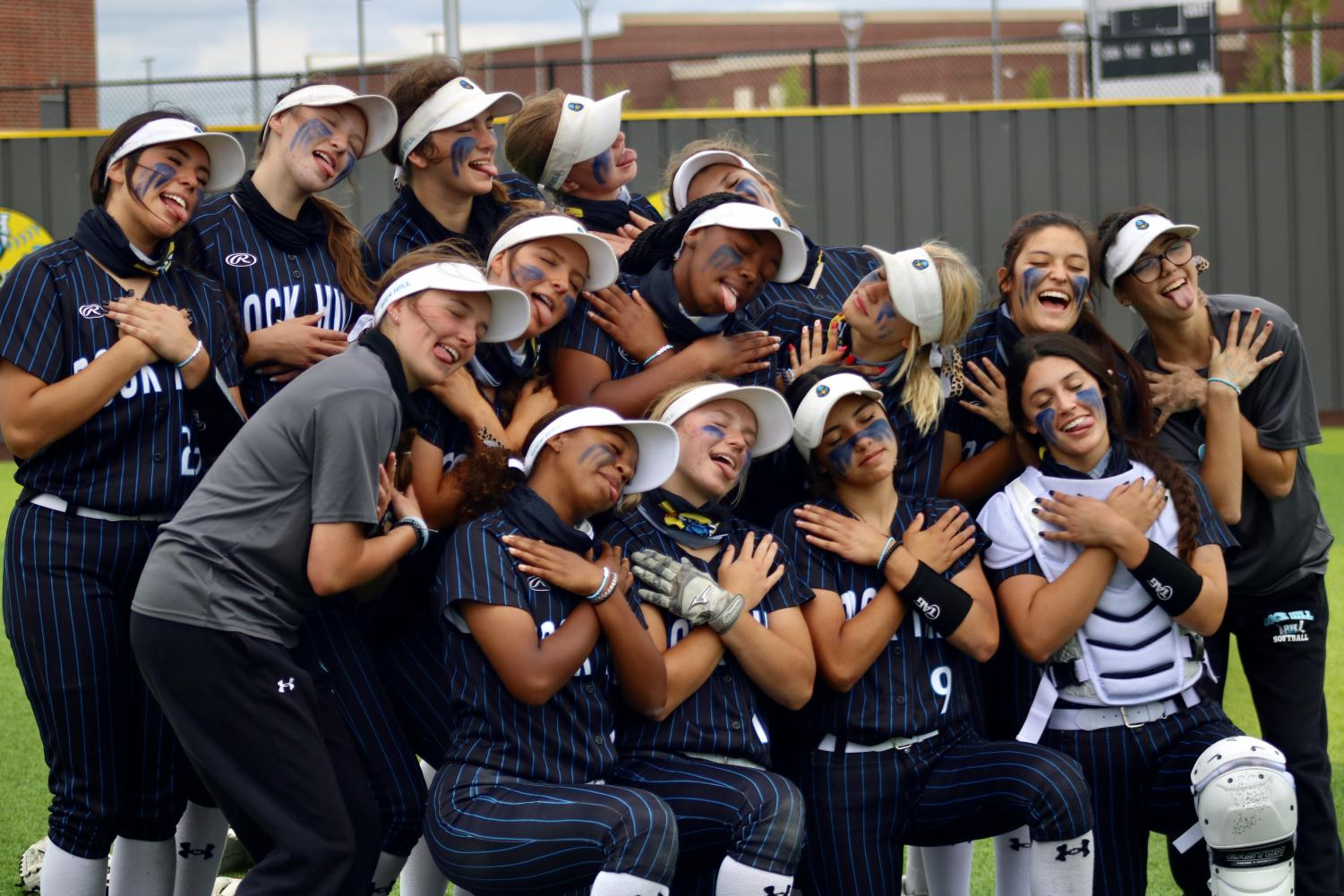 The girls softball team celebrates their district win. In their inaugural year, the girls became 5A district champs.