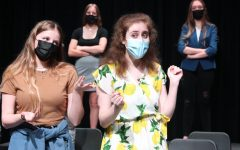 Senior Nikki Hansen and sophomore Lainey Cosgrove act out an ending scene of the musical theatre class's original musical. The cast of
