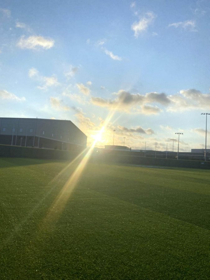 Senior and Editor-In-Chief Gianna Ortner-Findlay takes a picture of the sunrise on the morning of August 10th. The event took place at the RHHS baseball field, surrounded by evaporating early morning mist.