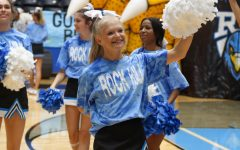 """The Cheer team prepares for every Pep Rally by  going over their routines and schedule of events in order to get into the right headspace and perform their best. """"This Pep Rally in particular was very special because it was the first real pep rally of the season and for Rock Hill, excluding the end of year pep rally last year,"""" said junior Hope Dyer. """"Thursday's pep rally really set the bar high for the upcoming ones this season."""""""