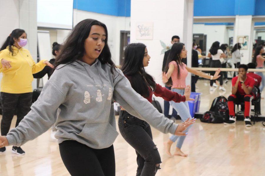 Bollywood dancers teach the choreography for