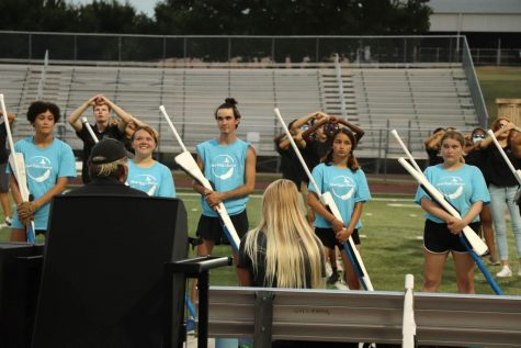 """Editor-In-Chief Gianna Ortner-Findlay captures Color Guard as they prepared to showcase a snippet of their competition piece, Dreams of Icarus. """"I like that you can learn something and that there"""