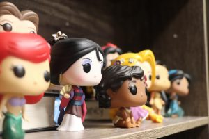 Photographer Dana Garcia captures a few of theatre director Sariea Haneys Funko Pops perched on a shelf in her office. [Disney is] magic and it lets everyone feel like a kid again. Haney said. The theatre director loves to collect different types of Funko Pop characters, especially Disney. The shelves have different themes of Funko Pops, and this one houses a few of the Disney Princesses.