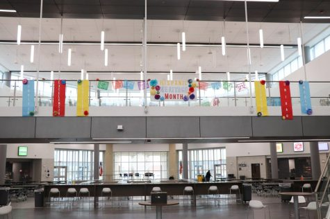 The Spanish Honor Society decorated the school for Hispanic heritage month, which included translating the core values into Spanish. The core values of Rock Hill High School are integrity, creativity, service, excellence, empathy and unity. We placed it there so that students and staff coming in could see it perfectly and constantly be reminded of the heritage month. SHS officer Maria Duron-Garcia said.